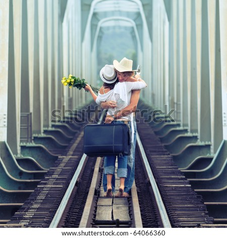 Young couple hugging on a train tracks