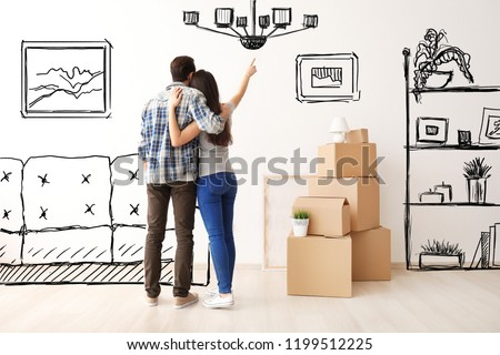 Young couple imagining interior of new house. Moving day