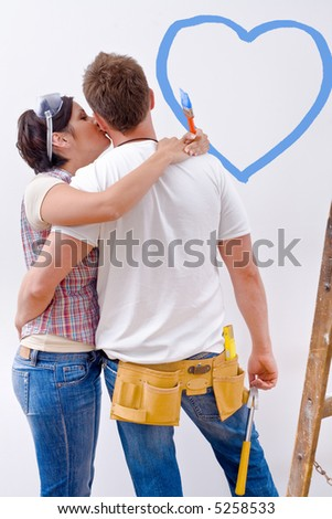 Young couple improving new home.