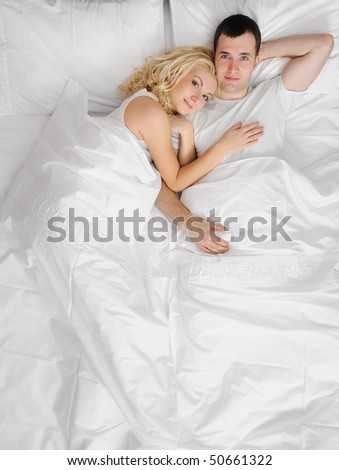 Young couple in a bed