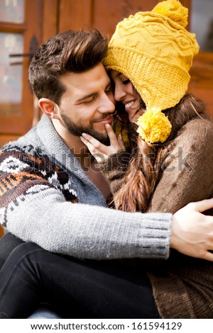 Young couple in a cabin in romantic scape in winter