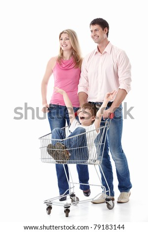 Young couple in a cart driven by his son on a white background