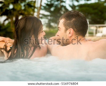 Young couple in a luxury hotel inside a jacuzzi enjoying the holidays