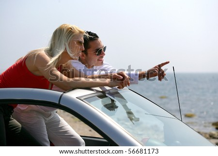 Young couple in an open-top car