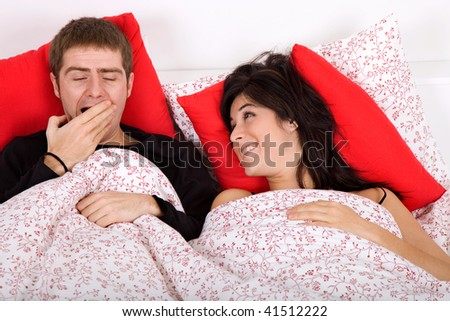 young couple in bed - stock photo