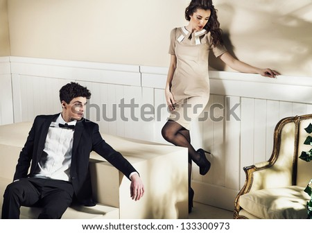 Young couple in elegant interior