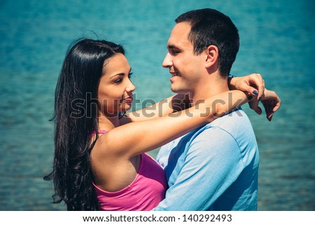 young couple in hug on the beach
