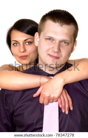 Young couple in hug over white background