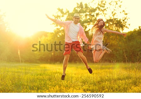 young couple in love having fun and enjoying the beautiful nature #256590592