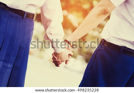 Young couple in love holding hands in summer, vintage tone