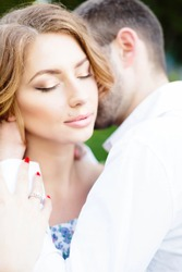 Young couple in love hug each other.Sensual romantic newlywed couple, hugging, face closeup