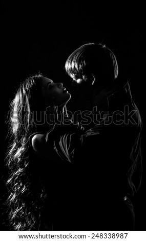 Young couple in love hugging each other, black and white photo
