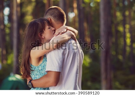 young couple in love hugging on the nature. man and woman outdoors