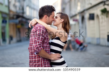 Young couple in love, hugging on the street. Selective focus.