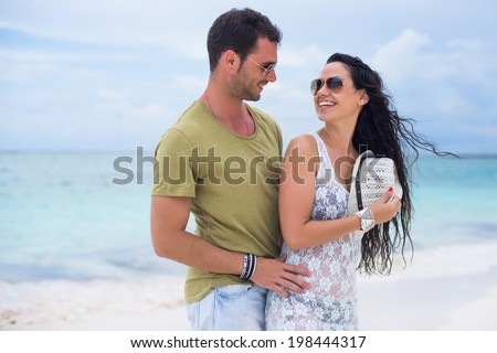 Young couple in love in a tropical beach