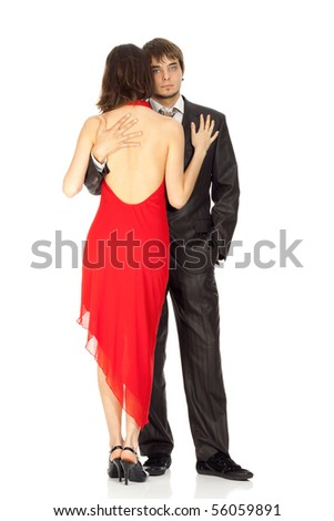 young couple in love in an evening dress isolated on white