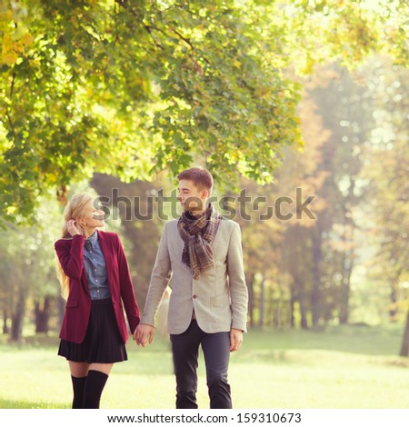 young couple in love in the park in autumn