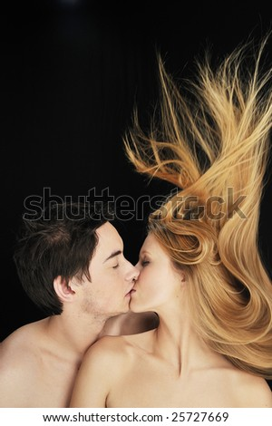 Young couple in love kissing each other