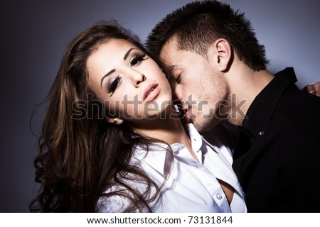 young couple in love kissing, studio shot