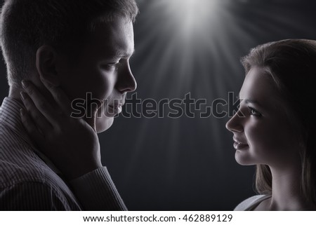 Young couple in love looking at each other on a black background #462889129