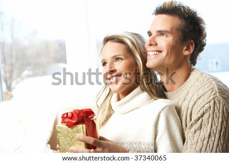 Young couple in love looking in the window
