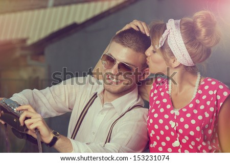 Young couple in love making self-portrait