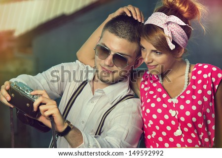 Young couple in love making self-portrait. Retro style.