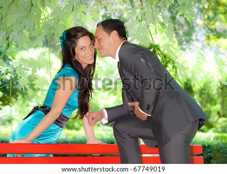 Young couple in love outdoor in a park