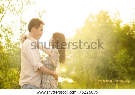 Young couple in love, outdoor in sunset