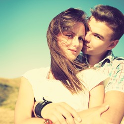 Young couple in love outdoor. Photo with instagram style filters