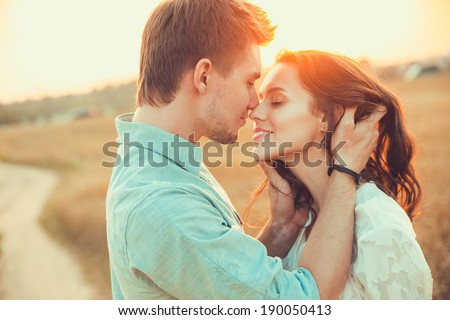 Young couple in love outdoor.Stunning sensual outdoor portrait of young stylish fashion couple posing in summer in  field #190050413