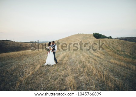 Young couple in love outdoors in Tuscany