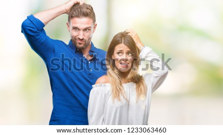 Young couple in love over isolated background confuse and wonder about question. Uncertain with doubt, thinking with hand on head. Pensive concept.