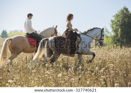 young couple in love riding a...