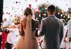 young couple in love.Wedding photo.Rose petals over a couple in love