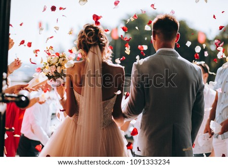 Photo of  young couple in love.Wedding photo.Rose petals over a couple in love
