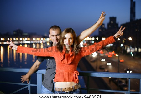 Young couple in night city - stock photo