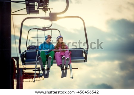 Young couple in sportswear on a lift #458456542