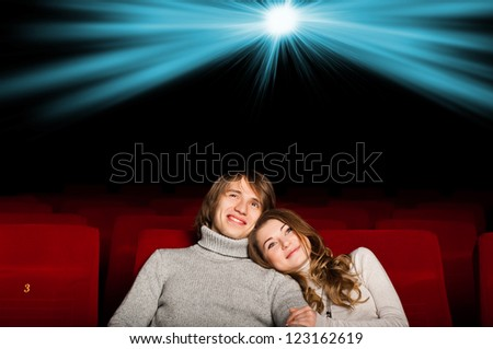 young couple in the cinema to enjoy the movie