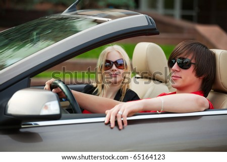 Young couple in the convertible.