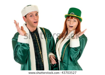 Young couple in traditional St Patrick holiday outfit. Studio shot.