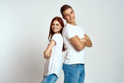 young couple in white T-shirts, emotions,   free place