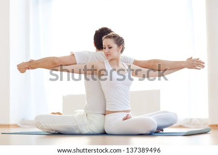 Young couple in yoga pose