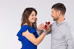 Young couple inlove celebrating St.Valentine's day with glasses of wine, drinking at bruderschaft.