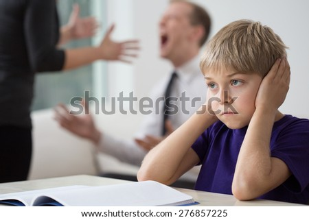 Young couple is arguing to loud alongside their child