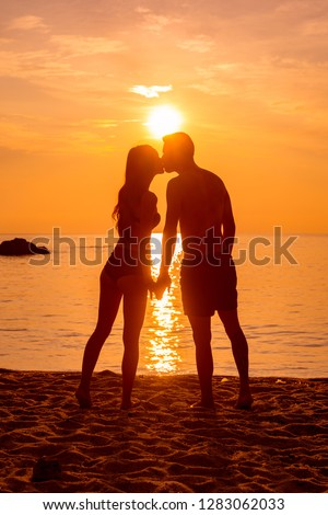 young couple is kissing at the sea #1283062033
