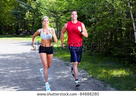 Young couple jogging in park. Health and fitness.