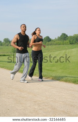 Young Couple Jogging Outdoor at Park under Summer Sky