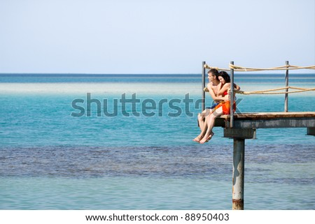 Young couple kissing on the sea