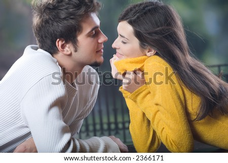 Young couple kissing, outdoors